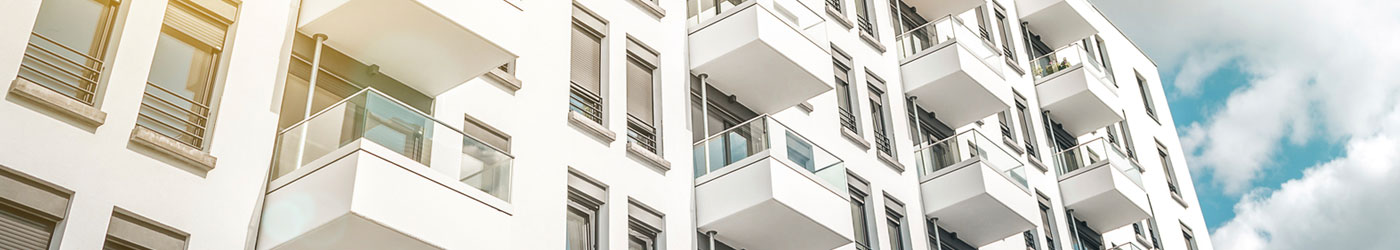 looking up at white condominium